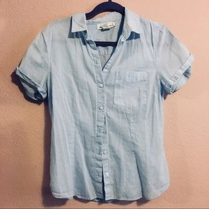 Light blue cotton blouse with short rolled sleeves